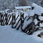 A fence covered by snow