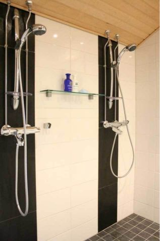 shower area with two showers